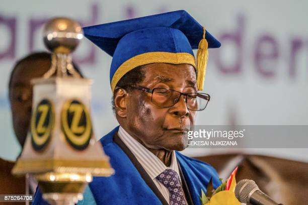 Zimbabwe's President Robert Mugabe delivers a speech during a graduation ceremony at the Zimbabwe Open University in Harare where he presides as the...