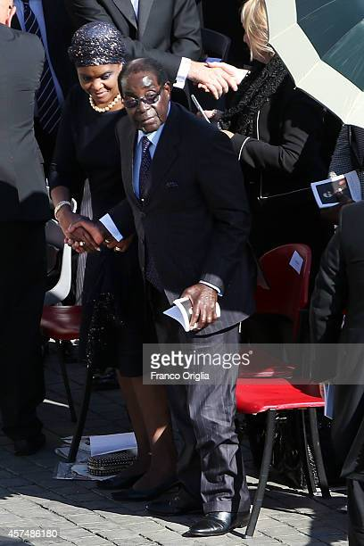 Zimbabwe's President Robert Mugabe flanked by his wife Grace attend the holy mass for the closing of Extraordinary Synod held by Pope Francis at St...