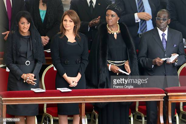 Zimbabwe's President Robert Mugabe flanked by his wife Grace attend the canonisations of Popes John Paul II and John XXIII held by Pope Francis in...
