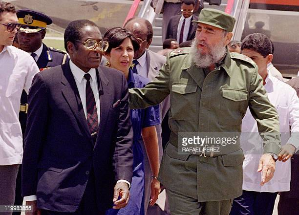 Zimbabwe's President Robert Mugabe is greeted 08 June 1992 in Havana by Cuban President Fidel Castro Mugabe Zimbabwean first Premier and President...