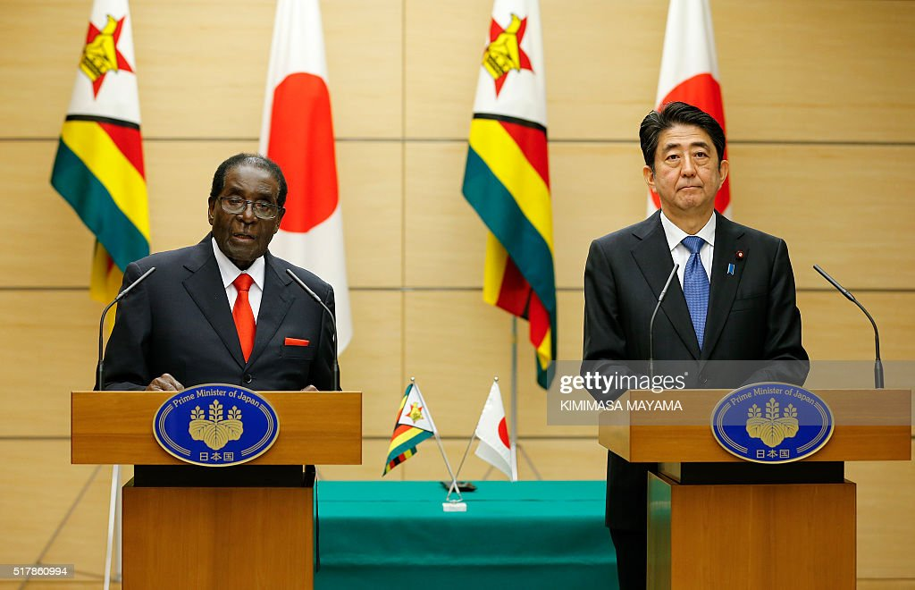 Zimbabwe's President Robert Mugabe (L) speaks as Japan's Prime Minister Shinzo Abe listens on, during a press conference after their talks at the latter's official residence in Tokyo on March 28, 2016. Mugabe arrived in Japan on March 27 for a five-day official working visit. / AFP / POOL / Kimimasa Mayama