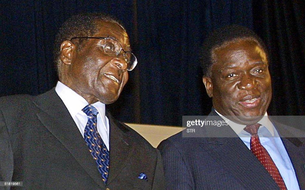 Zimbabwe's President Robert Mugabe (L) t : News Photo