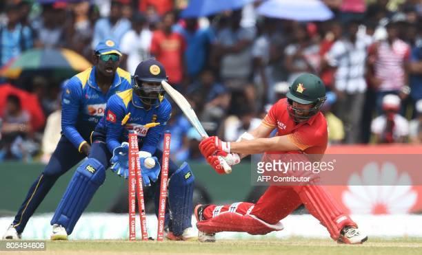 Zimbabwe's Ryan Burl is dismissed by Sri Lanka's Lakshan Sandakan as Sri Lankan wicketkeeper Niroshan Dickwella looks on during the second oneday...