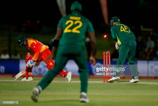 Zimbabwe's Sean Williams is stumped out by South Africa's wicketkeeper Heinrich Klaasen during the second One Day International cricket match between...