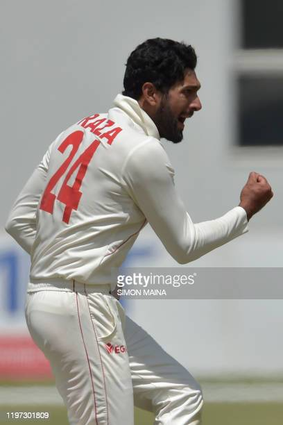 Zimbabwe's Sikandar Raza celebrates after the dismissal of Sri Lanka's Kusal Mendis during the third day of the second Test cricket match between...