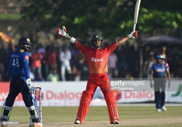 Zimbabwe's Sikandar Raza celebrates the victory of the first oneday international cricket match between Sri Lanka and Zimbabwe at the Galle...