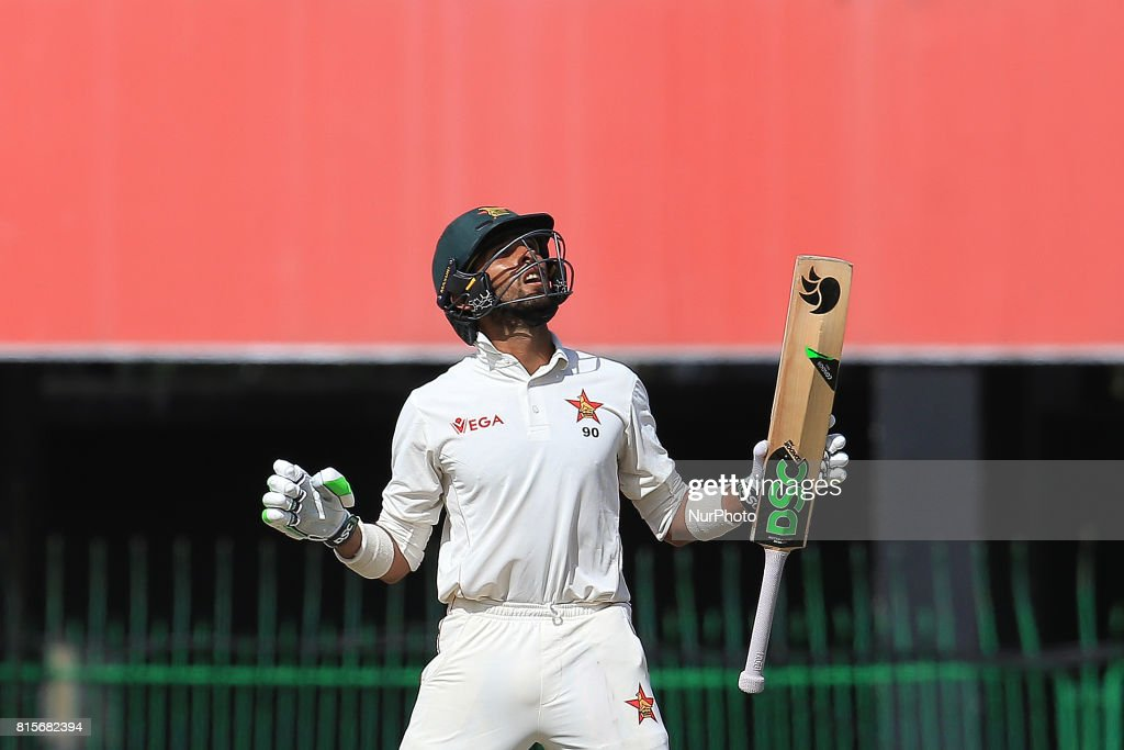 Zimbabwe's Sikandar Raza looks up to the sky and reacts after scoring fifty runs during the third day's play of the only test cricket match between Sri Lanka and Zimbabwe in Colombo, Sri Lanka, Sunday, July 16, 2017