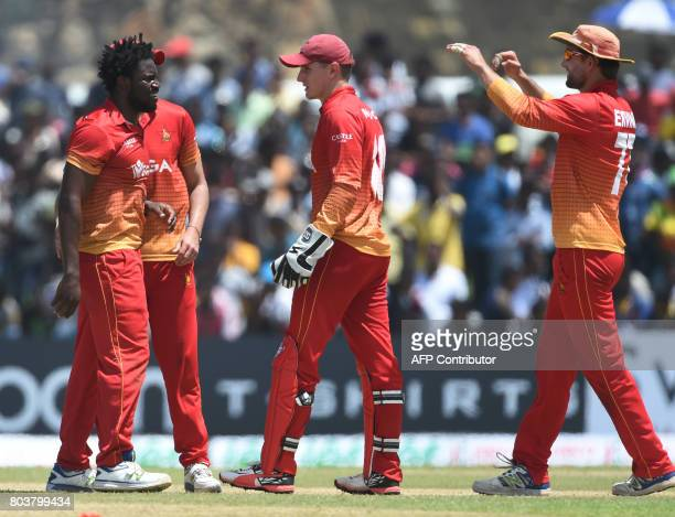 Zimbabwe's Solomon Mire celebrates with his teammates after he dismissed Sri Lanka's captain Angelo Mathews during the first oneday international...