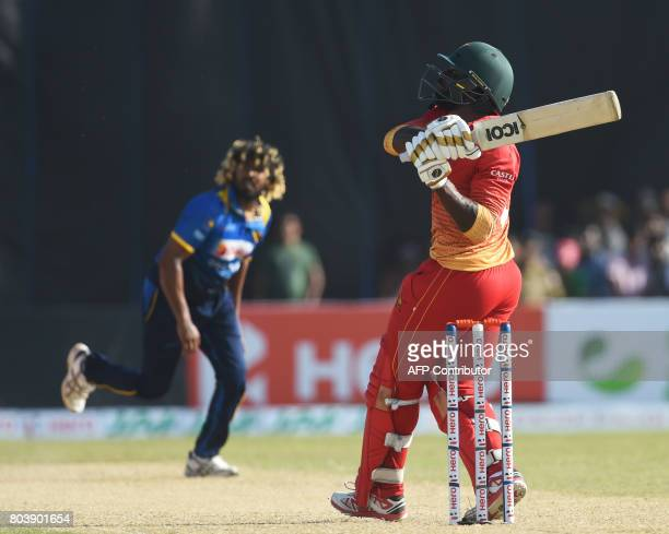 Zimbabwe's Solomon Mire plays a shot during the first oneday international cricket match between Sri Lanka and Zimbabwe at the Galle International...