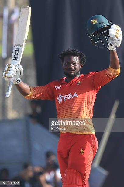 Zimbabwe's Solomon Mire raises his bat after scoring his maiden ODI hundred against the Sri Lankan team in their 1st ODI match at the Galle...
