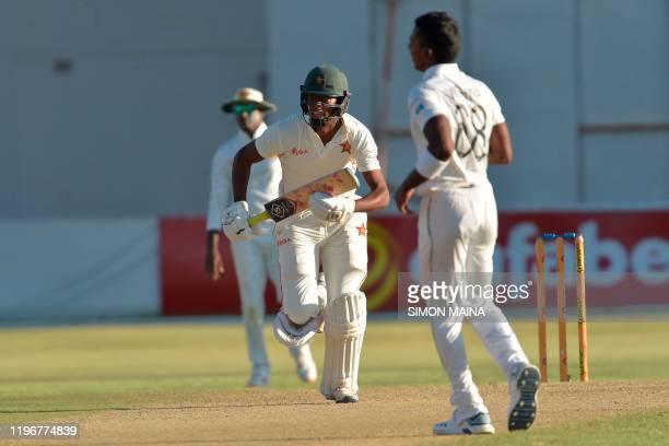 Zimbabwe's Tinotenda Mutombodzi runs between the wickets past Sri Lanka's Oshada Fernando during the first day of the second Test cricket match...