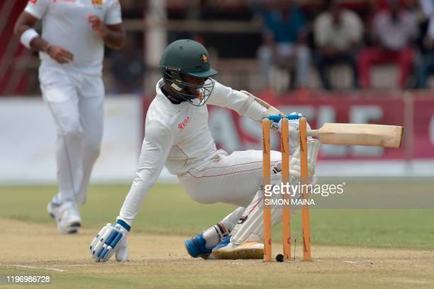 Zimbabwe's Victor Nyauchi reacts after being hit by a ball delivired by Sri Lanka's Lahiru Kumara during the second day of the second Test cricket...