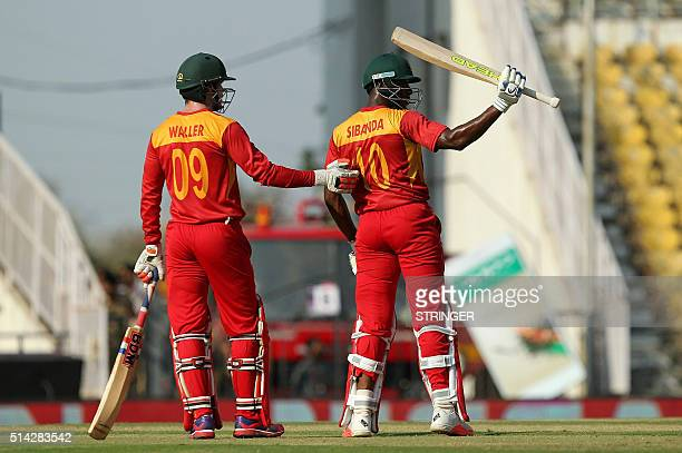 Zimbabwe's Vusi Sibanda acknowledges the crowd afer scoring a halfcentury during the opening match of the T20 Cricket World Cup against Hong Kong in...