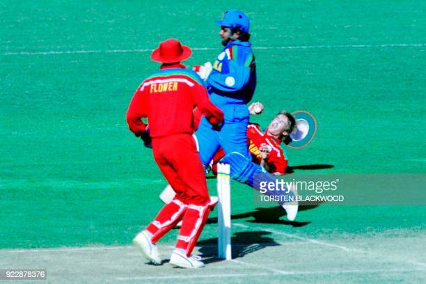 Zimbabwe's Wayne James falls to the ground whilst trying to run out Sri Lanka's Arjuna Ranatunga during the World Cup Cricket match between Zimbabwe...