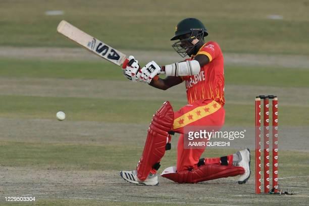 Zimbabwe's Wesley Madhevere plays a shot during the first Twenty20 cricket match between Pakistan and Zimbabwe at the Rawalpindi Cricket Stadium in...