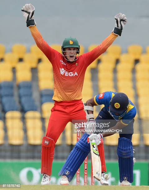 Zimbabwe's wicketkeeper Peter Moor successfully appeals for a Leg Before Wicket decision against Sri Lankan cricketer Danushka Gunathilaka during the...