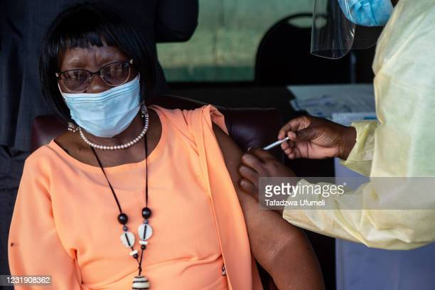 Zimbabwe's Women Affairs and Development minister Sithembiso Nyoni receives her first first dose of the Sinovac COVID-19 vaccine on March 24, 2021 in...