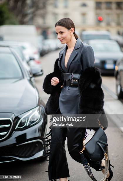 Zina Charkoplia is seen wearing black leather jacket Dior saddle bag pants outside Roberto Cavalli on Day 4 Milan Fashion Week Autumn/Winter 2019/20...