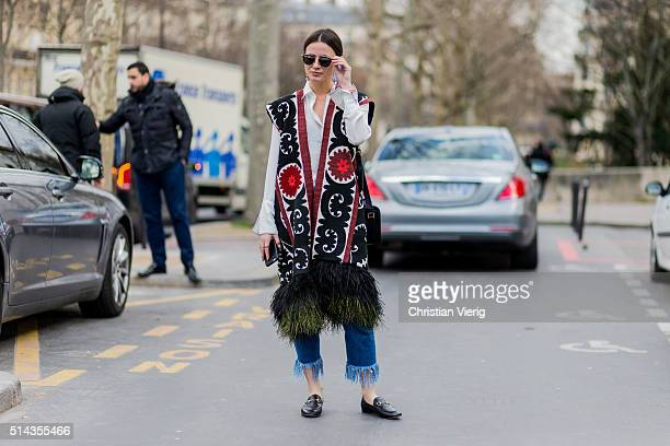 Zina Charkoplia is wearing a Sandra Mansour feather gilet and Gucci loafers outside Ellery during the Paris Fashion Week Womenswear Fall/Winter...