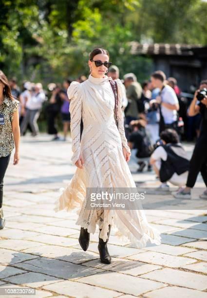 Zina Charkoplia wearing dress is seen outside Roberto Cavalli during Milan Fashion Week Spring/Summer 2019 on September 22 2018 in Milan Italy