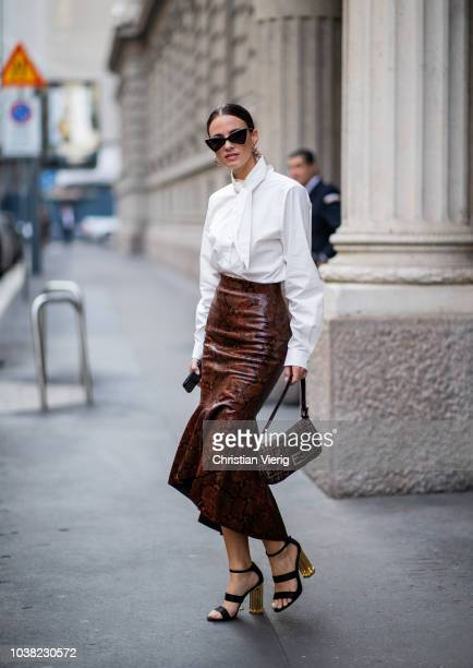 Zina Charkoplia wearing skirt with snake print white blouse is seen outside Salvatore Ferragamo during Milan Fashion Week Spring/Summer 2019 on...