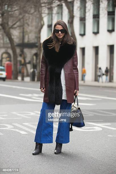 Zina Charkoplia wears Celine sunglasses and bag with an HM jacket shirt and shoes and Zara pants during London Fashion Week Fall/Winter 2015/16 at...