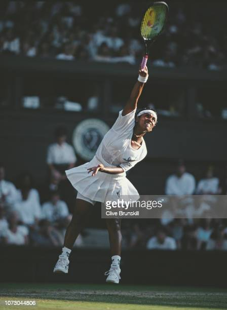 Zina Garrison of the United States serves to Arantxa Sanchez Vicario of Spain during their Women's Singles Fourth Round match at the Wimbledon Lawn...