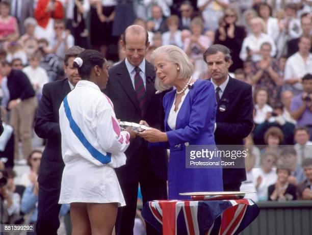 Zina Garrison of the USA is presented with the runnersup trophy by Katharine Duchess of Kent and the Duke of Kent after the Women's Singles Final of...