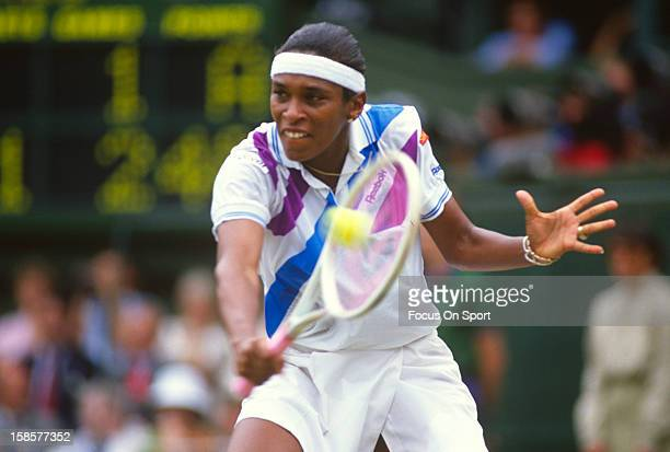 Zina Garrison of the USA returns a shot during the Women's singles at the Wimbledon Lawn Tennis Championships circa 1990 at the All England Lawn...