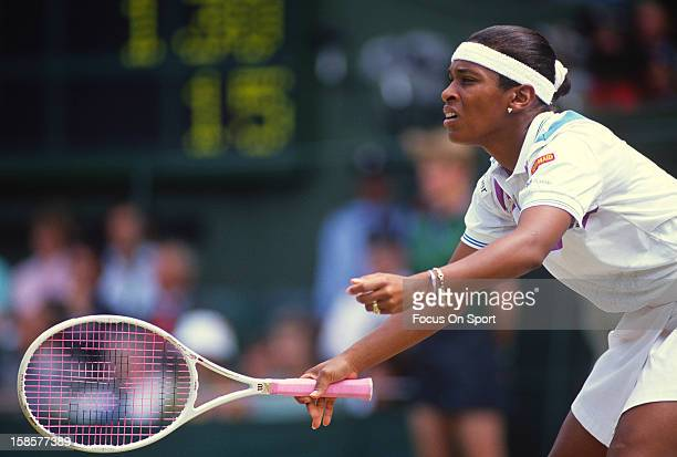 Zina Garrison of the USA set returns a shot during the Women's singles at the Wimbledon Lawn Tennis Championships circa 1990 at the All England Lawn...