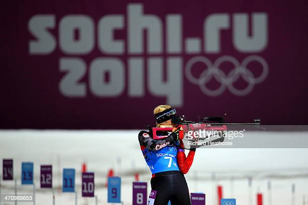 Zina Kocher of Canada competes at the shooting range during the Women's 4 x 6 km Relay during day 14 of the Sochi 2014 Winter Olympics at Laura...