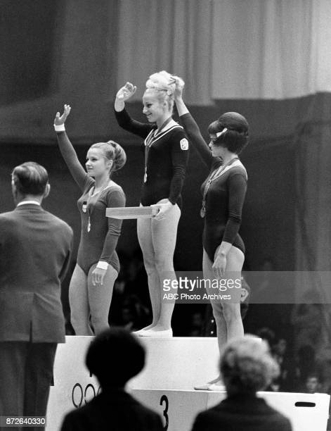 Zinaida Voronina Vera Caslavska Natalia Kuchinskaya medal ceremony at 1968 Olympics