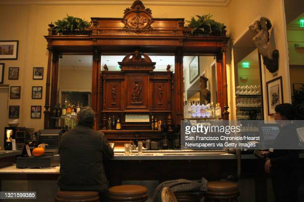 Zinc bar at the Cliff house, which has a zinc bar top and a hand-carved back bar. Zinc tabletops were popular n France during the early 1900's, and...