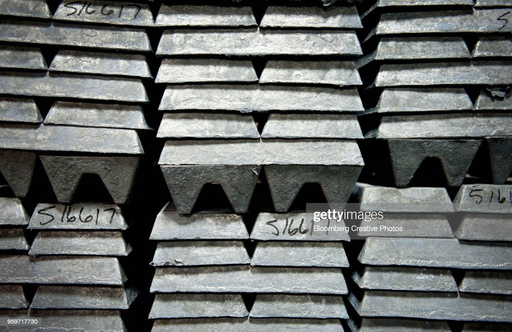 Zinc ingots, used to coat galvanized nails, sit stacked in a warehouse : Stock-Foto