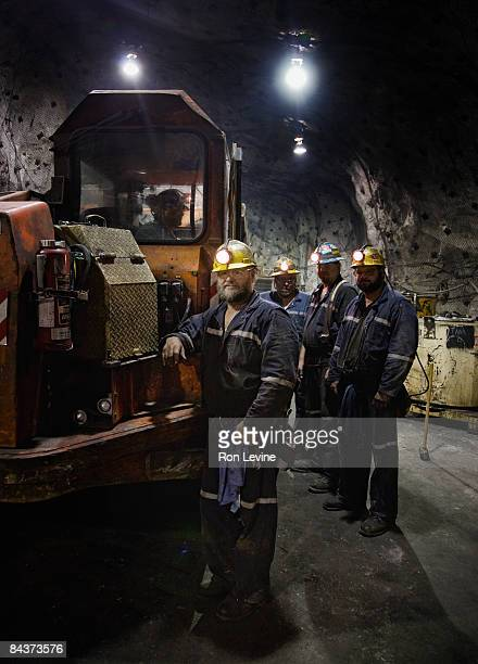 zinc miners with a 40-ton mine truck, portrait - underground mining stock photos and pictures