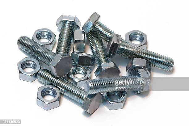 Zinc plated nuts and bolts isolated on white