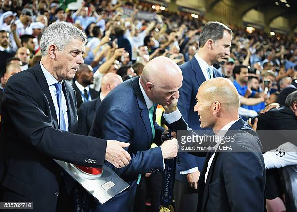 Zinédine Zidane, head coach of Madrid is congratulated by Gianni Infantino, FIFA President and Ángel María Villar Llona, first vice president of UEFA...