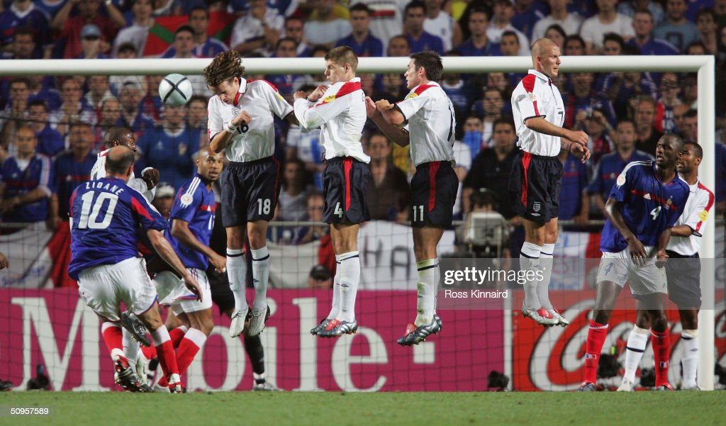 Zinedin Zidane of France scores their first goal during the France v England Group B match in the 2004 UEFA European Football Championships at the Estadio da Luz on 13 June, 2004 in Lison, Portugal.