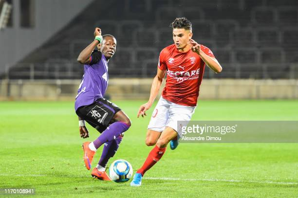 Zinedine FERHAT of Nimes and Max-Alain GRADEL of Toulouse during the Ligue 1 match between Nimes and Toulouse on September 21, 2019 in Nimes, France.