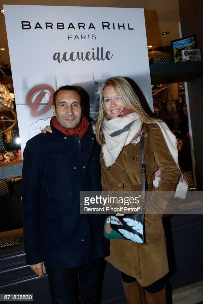 Zinedine Soualem and Caroline Faindt attend Reem Kherici signs her book 'Diva' at the Barbara Rihl Boutique on November 8 2017 in Paris France