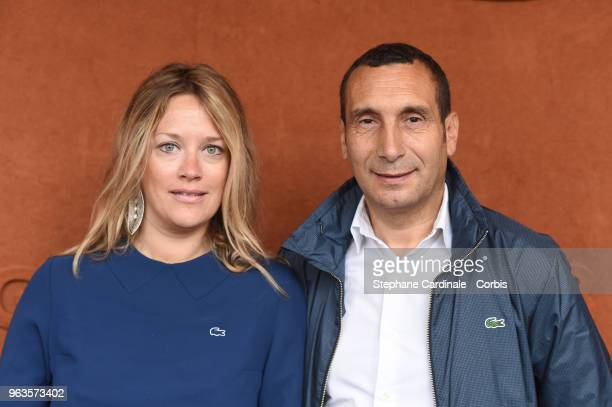 Zinedine Soualem and Caroline Faindt attend the 2018 French Open Day three at Roland Garros on May 29 2018 in Paris France
