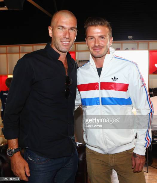 Zinedine Zidane and David Beckham at the adidas Olympic Media Lounge at Westfield Stratford City on August 11 2012 in London England