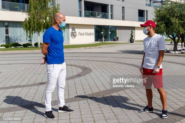 Zinedine Zidane and Eden Hazard of Real Madrid attend Valdebebas training ground as Real Madrid prepare to return to training after a suspension...