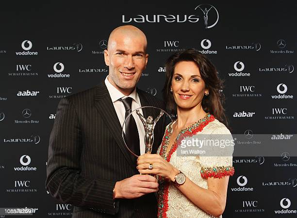 """Zinedine Zidane and guest pose with his award for """"Laureus Lifetime Achievement Award"""" in the winners studio at the 2011 Laureus World Sports Awards..."""