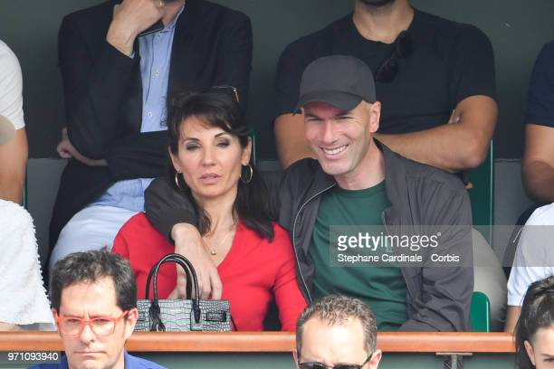 Zinedine Zidane and his wife Veronique attend the Men Final of the 2018 French Open Day Fithteen at Roland Garros on June 10 2018 in Paris France