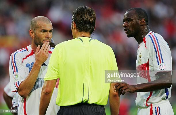 Zinedine Zidane and Patrick Vieira of France appeal with Referee Roberto Rosetti following his award of a penalty to Spain during the FIFA World Cup...