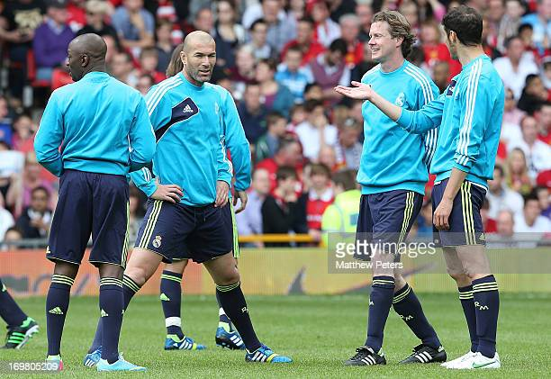 Zinedine Zidane and Steve McManaman warm up for the Legends match between Manchester United Legends and Real Madrid Legends at Old Trafford on June 2...