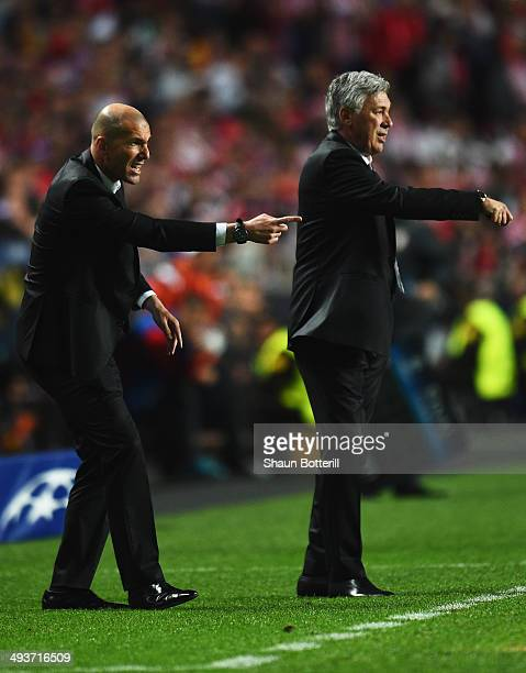 Zinedine Zidane assistant manager of Real Madrid and Carlo Ancelotti manager of Real Madrid signal during the UEFA Champions League Final between...