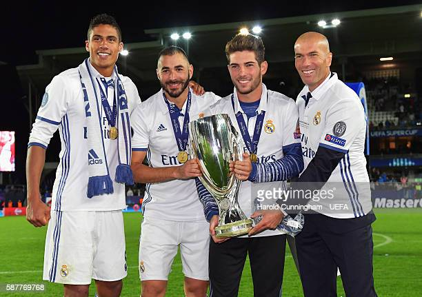 Zinedine Zidane Coach of Real Madrid poses with son Luca Raphael Varane and Karim Benzema after the UEFA Super Cup match between Real Madrid and...