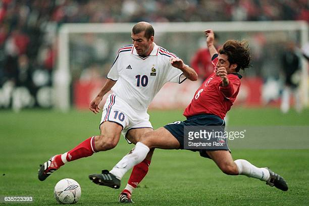 Zinedine Zidane from France and Clarence Acuna from Chile during a friendly match